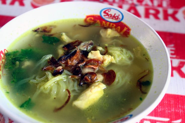 Soto ayam, yellow spicy chicken soup.