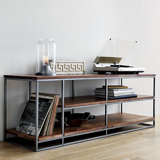 Open shelving displays flat screen up top, audio and video gadgets below. Asymmetric design features taller storage at one end to host LPs and gaming towers. Also doubles as room divider, bookcase or elevated coffee table.