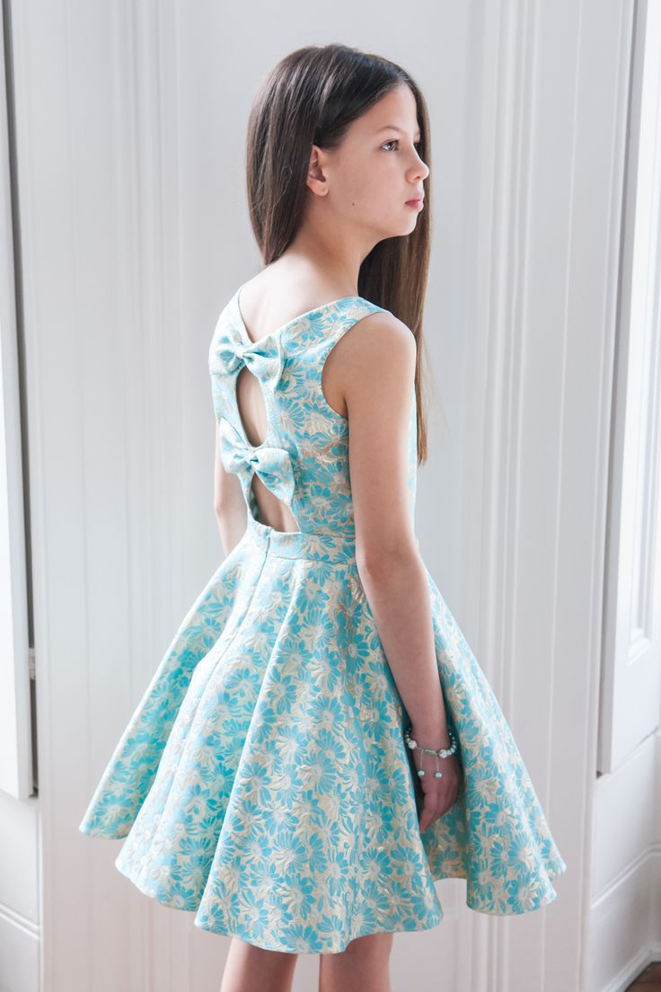 Now is the time for your sweetheart to take centre stage with this polished turquoise floral party dress, available from our S/S '16 collection. Ideal for glamorous evening occasions like proms, parties and birthday celebrations, your girl will be all smiles when she adds this colourful addition to her new season wardrobe. Available in an immaculate shade of ivory with complimentary turquoise accents on a floral brocade throughout, this mid-length designer dress is as elegant as they come…