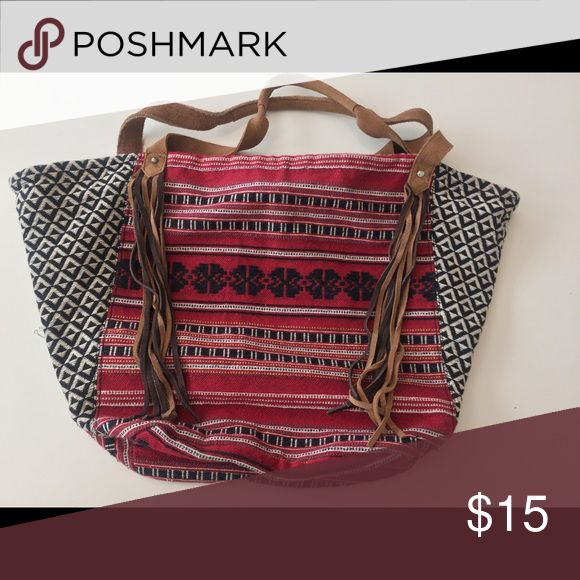 Handbag Can be used for beach trips, or overnight trips, or for whatever! Soft shell, with two mini pockets in side. Super cute fringe, and tribal pattern on the outside. With nice, soft leather feeling handles. American Eagle Outfitters Bags Totes