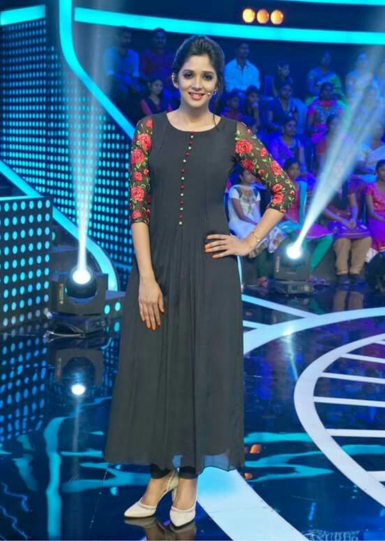 Cute  Nyla Usha in black outfit | floral embroidery