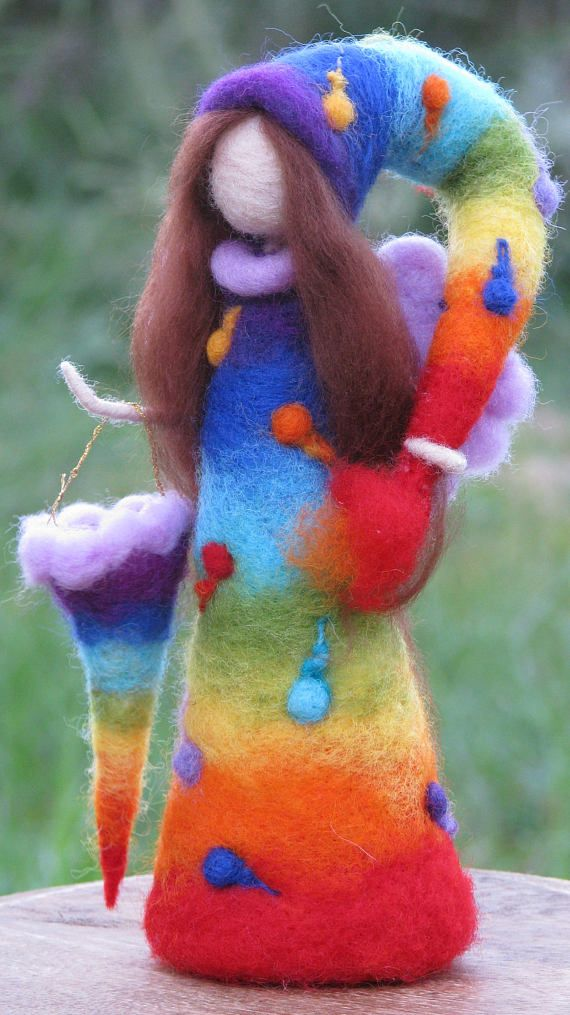 Rainbow Fairy. She is full of colors, holding her hat as a brush and in another hand a can of rainbow colors. She is the one who paints all the amazing rainbows at the sky. Needle felted Waldorf inspired art doll, Rainbow Fairy. Fantasy doll, Waldorf fairy. Home decor. Size 9-10 She
