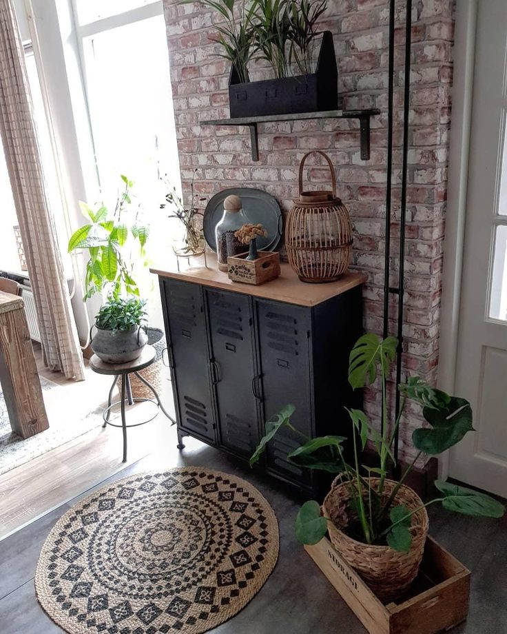 Urban Jungle Vibes! In this home, green plants and interior pieces provide a …
