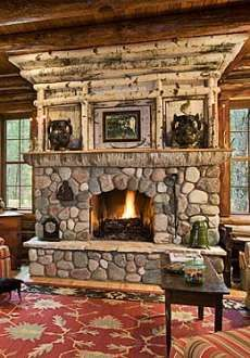 rustic stone fireplace in a log home