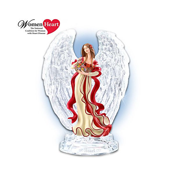 """Crystal-Winged Heart Health Awareness Angel Figurine This stunning fully sculpted figurine is expertly handcrafted in the tradition of Rhodes Studios, with dazzling crystal wings and a crystal base inscribed with the single poignant word, """"Heart."""" The angel's serenely expressive face and graceful torso are hand-painted, highlighted by ribbons of rich red symbolizing women's heart disease prevention and awareness."""