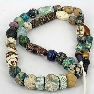 Ancient Glass Bead Strand with Heavy Patina