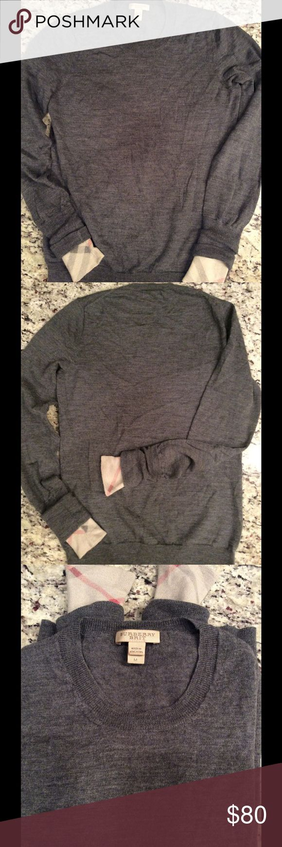 "-Burberry Brit- 100% Extra Fine Merino Wool Sz M Really cute sweater! Used, but good condition. Original Checker pattern in sleeves when rolled or pushed up. 100% Extra Fine Merino Wool. Their Sweaters do run small.  Small amount of unraveling in left armpit, see photo! Neck to hem 22"" armpit to armpit 15"" sleeve 24"" Burberry Sweaters Crew & Scoop Necks"