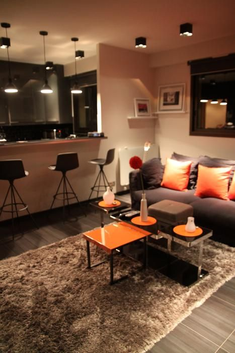 Appartement Masculin Colore....I LOVE bright colors! Loving the Orange (: