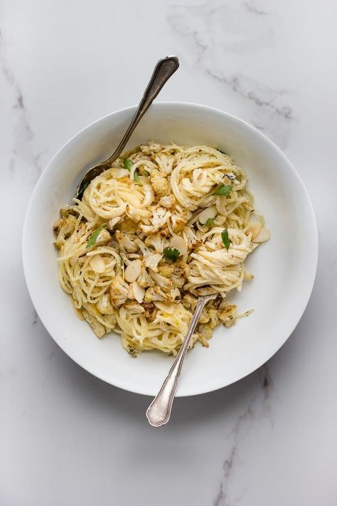 Roasted cauliflower pasta with lemon garlic ricotta, caramelized shallots + toasted almonds. Simple prep results in a stunning bowl of spaghetti.