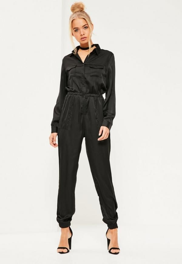 This luxe all black satin jumpsuit is our current obsession! With long sleeve, seriously dreamy embroidered feature to the back and button down front - all eyes will be on you!