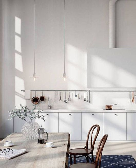 interior style | scandinavian inspired kitchen with white walls and white washed table | simple white cupboards