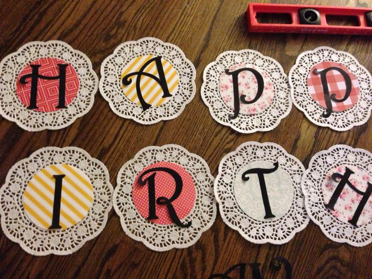 Homemade birthday banner using doilies
