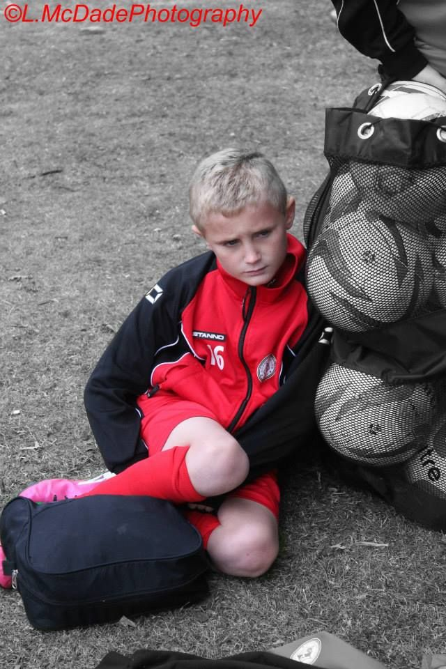 Pre football photograph (using colour splash again) very strong lost in the moment photograph