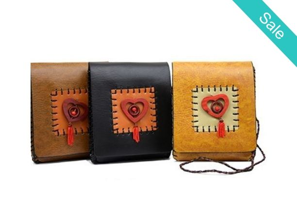 """Charming Phone and etc. Purse - Description: Vegan leather Navajo messenger with braided strap, sides and a heart center charm with small tassel detail. It has an interior pocket and magnetic closure.Measures: 6""""L x 1""""W x 7.5""""H Perfect low profile easy to carry phone and DL!  - On Sale for $24.00 (was $29.00)"""