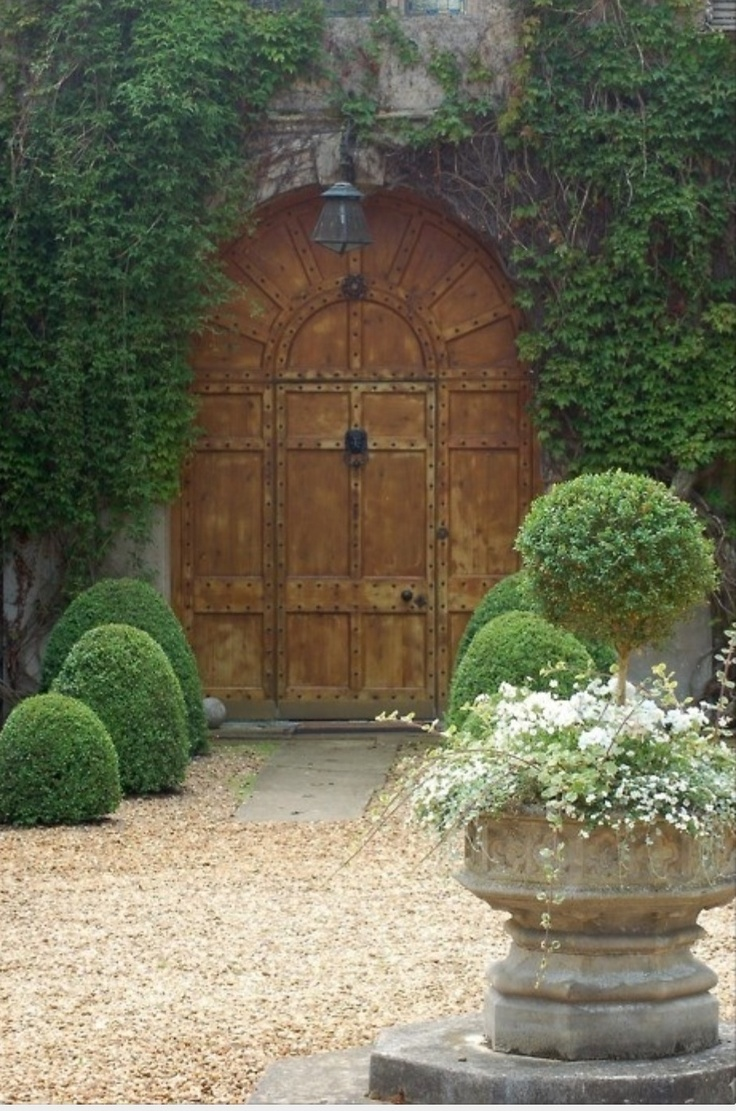 The doors, the English garden - mysterious but welcoming.