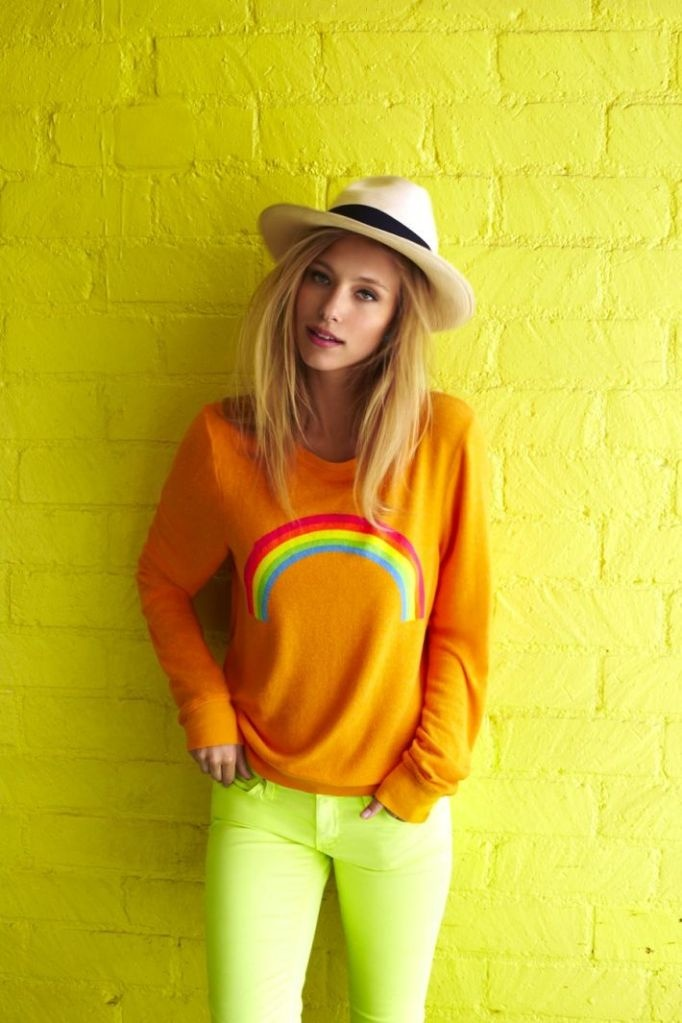 """Neon yellow jeans paired with an orange rainbow sweatshirt. Perfect outfit for your happy """"nothing can stand in my way"""" day."""
