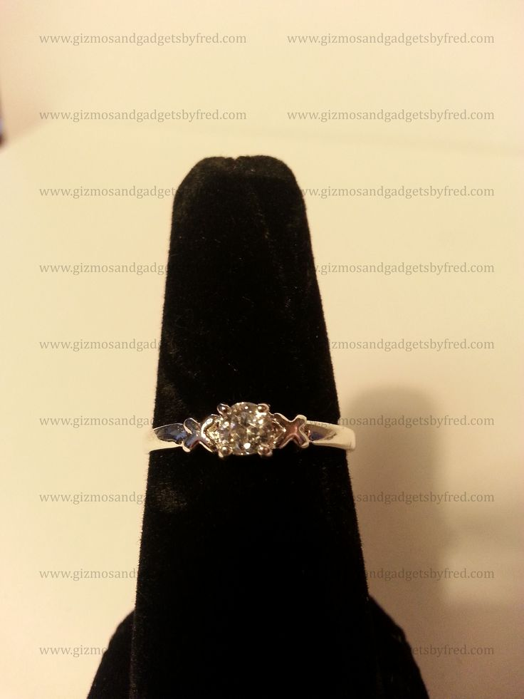Beautiful 18k white gold plated sterling silver ring. Cubic Zirconia of top quality. Very Sleek and Classy. Great buy for any women looking for a inexpensive but high quality jewelry to wear. Under 10$ at gizmosandgadgetsbyfred.com