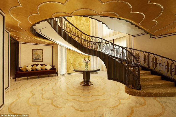 Two storeys: The lavish suite - which costs £16,000 a night - boasts grand decor and a swe...