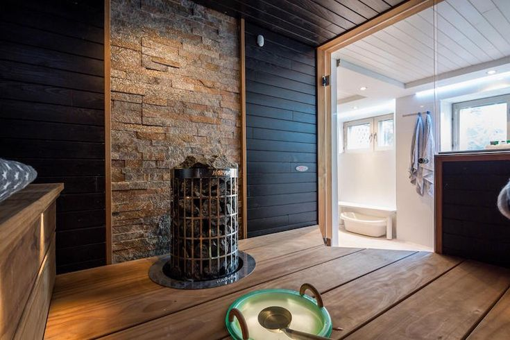 Sauna with dark walls