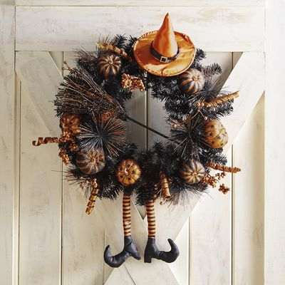 Hunting for a frightfully fun way to welcome costumed characters and party guests? Our enchanting witch hat wreath does the trick. Its glittered ornaments, dangling legs and pointy orange hat cast a snazzy spell on your covered front door—no newt eyes or dragon teeth required.