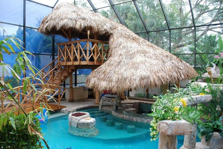 Tropical Swimming Pool with picture window, exterior stone floors, Indoor pool, Swim up bar, Deck Railing, Gazebo