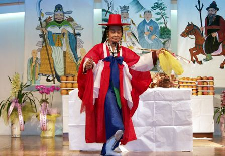 Mudang performing a ritual placating the angry spirits of the dead - Korean shamanism - Wikipedia, the free encyclopedia
