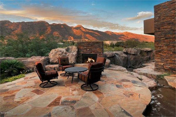 A Southwest design - The elements that create the Southwest atmosphere of this patio are obvious. Earth tone flagstone and other stone work create the atmosphere without any other help than from the borrowed scenery.