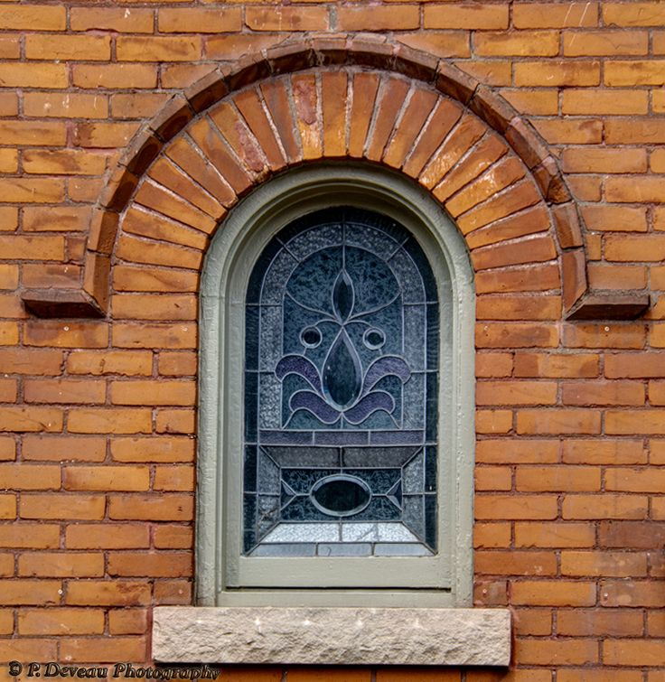 Just a decorative window built to the side of the main entrance of a single family dwelling. Located on Hess St. in Hamilton, Ontario. Built circa 1894.
