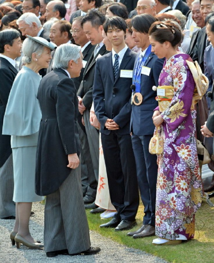 Japan's Emperor Akihito (3rd L) and Empress Michiko (2nd L) greet Japanese medalists at the Sochi Olympics, Yuzuru Hanyu (3rd R), Noriaki Kasai (2nd R), and Tomoka Takeuchi (R), during the annual spring garden party at the Akasaka Palace imperial garden in Tokyo on 17.04. 2014.