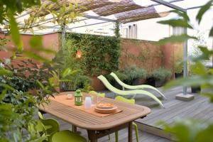 """When landscape architect Gabriella Mazzola designed a roof garden for her clients atop a modern residential building in Italy, she understood why they asked for """"a green oasis of relaxation."""" Her gentle hand with a feel for fine-textured plants creates a remarkable transformation and allows light to penetrate while providing screens for backgrounds and privacy. This space features a dozen great ideas for adding warmth and contrast to cold hard surfaces."""