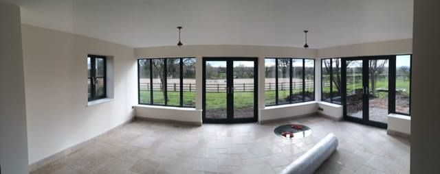This was a recent project we completed in Cheshire. The windows and doors are from our Schuco range, we also installed a well cover in this room using toughened glass.