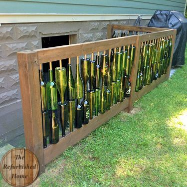 Create a one of a kind decorative fence with recycled wine bottles.