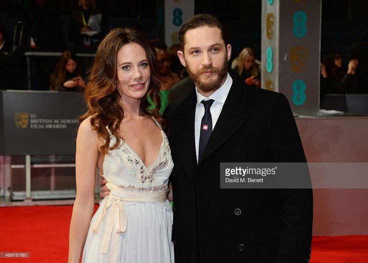 Kelly Marcel (L) and Tom Hardy attend the EE British Academy Film Awards 2014 at The Royal Opera House on February 16, 2014 in London, England.