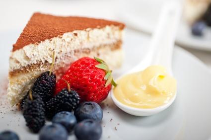 Classic italian tiramisu dessert with berries and custartd pastry cream on side :)