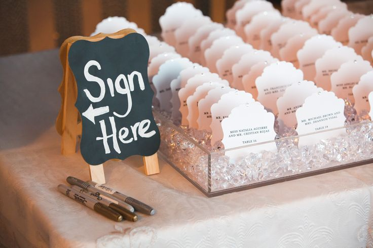 Seating Cards - Arranged very precisely in a transparent tray filled with small crystals http://www.fusion-events.ca/