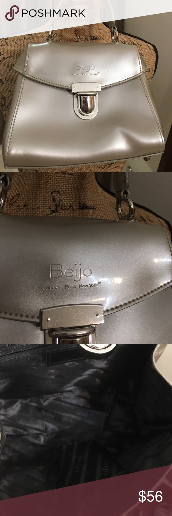 """Beijo Champagne Adorable Mini Bag. Vegan Patent Ever so sweet of a bag.   Taupe / Champagne color.  Not sure I should part with it.  Cute as a button. 7.5"""" wide x 6.5 tall.  Clean inside. Minor scuff on the back....only noticeable when the light hits it right.   Offers accepted. beijo Bags Mini Bags"""