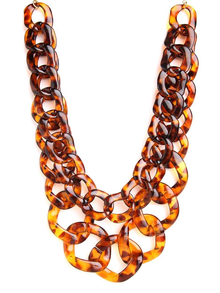 Indulge in the tony, Uptown allure of this stunning statement necklace. It features two glorious strands of chunky tortoiseshell links for a look that's Jackie O-glamorous.