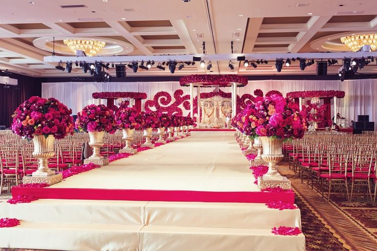 Elevated Aisle with Fuchsia Flowers    Photography: Studio AvantGarda