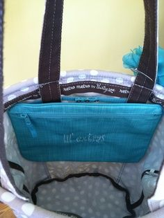 Seriously?  This is so smart.  Makes a great bag even BETTER! The Retro Metro Bag shown here with Pocket a Tote from Thirty-One Gifts