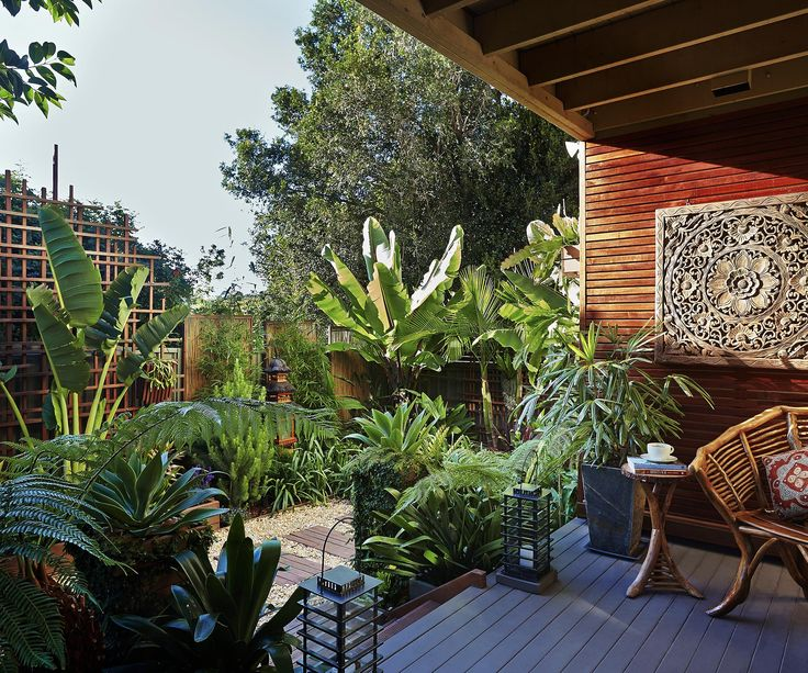Sea-changers turn their much-longed-for courtyard into a tropical garden oasis with lush plantings, clever design and recycled materials, all on a tight budget.