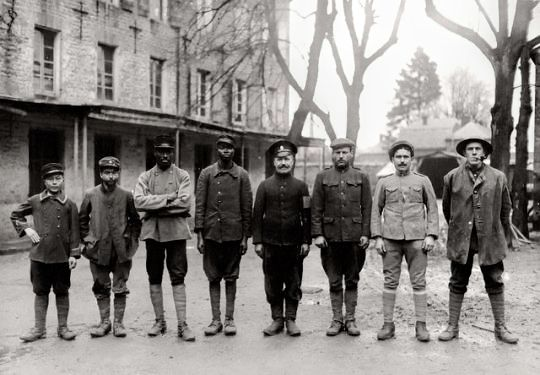 Western front, a group of captured Allied soldiers representing 8 nationalities - Anamite (Vietnamese), Tunisian, Senegalese, Sudanese, Russian, American, Portuguese, and English