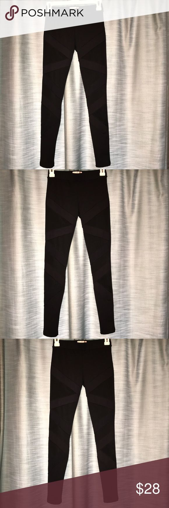 Leggings with mesh designs Leggings with crisscross mesh designs on the front. These were worn twice and are in great condition just haven't worn them anymore. Let me know if you have any questions! Pants Leggings