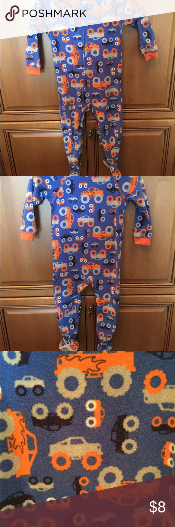 Toddler boys footed pajamas Toddler boys footed pajamas in a size 3T.  The brand is Child of Mine by Carter's.  The pattern is so cute, it's a truck design.  These are pre-owned, but are in good used condition- some nubs, but no holes.  These are great to keep your little one nice and warm and cuddly! Child of Mine by Carter's Intimates & Sleepwear Pajamas
