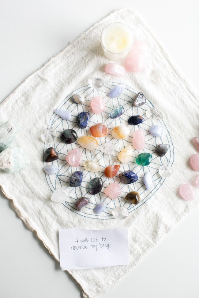 Learn how to make a crystal grid for health and wellness and harness the power of crystals and stones working together with a specific intention.