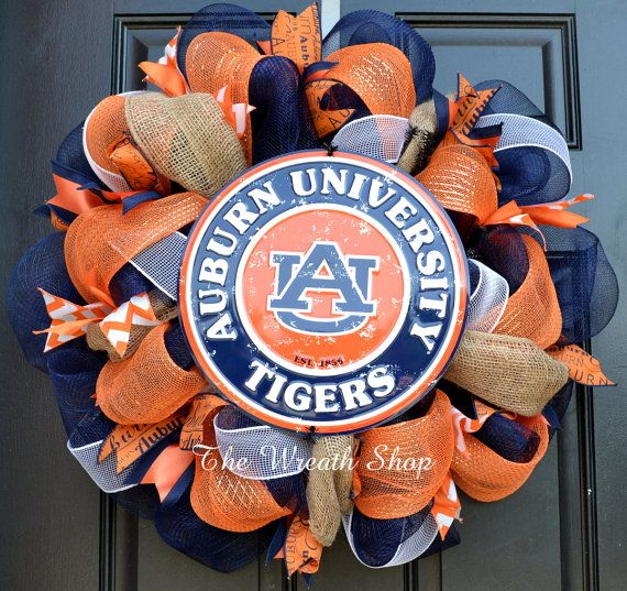 Cheer on Auburn this fall with this adorable Mesh Auburn Wreath adorning your door. It is made on a navy colored deco mesh with orange and