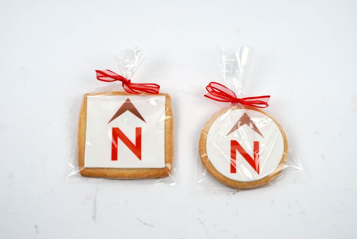 Hand tied ribbon and bows adorn most of our custom decorated shortbread cookies