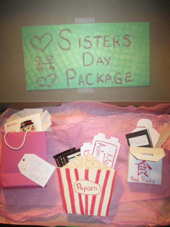 "Homemade ""Sisters' Day Package"" as a Christmas present for my little sister.  Gift card for shopping spree, movie tickets (and chocolate to eat in the theater), and lunch at our favorite restaurant :)"