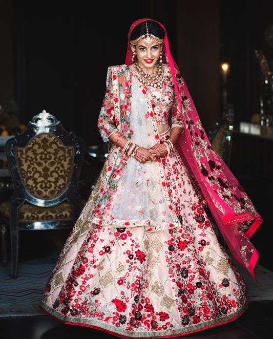 For her wedding, Riddhima Mehta wanted an outfit that included colors traditionally worn by brides in the Indian state of Gujarat. She conceived a custom design with Varun Bahl, which was hand-embroidered and lightweight enough to not impede her dancing late into the night. (Photo: WeddingNama)