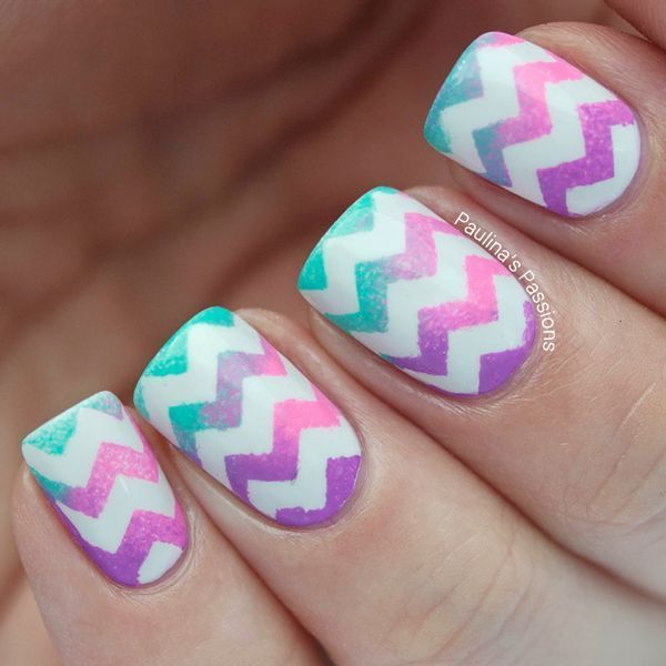 A cute gradient nail art design with violet, pink and aquamarine combination topped with bold zigzag details in white polish. #claws
