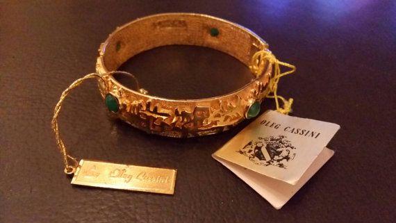 Check out this item in my Etsy shop https://www.etsy.com/it/listing/252484650/oleg-cassini-signed-bracelet-genuine